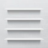 Four white realistic shelves against brick wall Stock Photo
