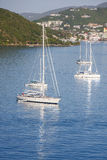 Four White Sailboats in Blue Bay Royalty Free Stock Images