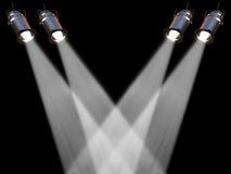 Four  white spot lights. Two white spot lights on black background Stock Photo