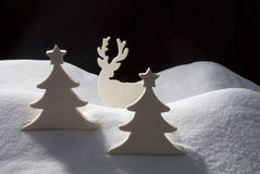 Four White Wooden Christmas Trees, Snow Royalty Free Stock Photography