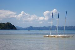 Four white yachts in tropical sea, Philippines. Scenic tropical landscape with boats and mountains on horizon. Summer vacation and travel. Idyllic lagoon in stock photos