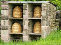 Four Wicker Beehives. Stock Photography