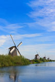 Four Windmills in row Stock Photos