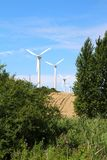 Four windmills in a row Stock Image