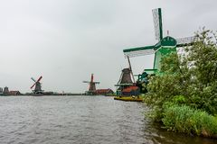 Four windmills at the Zaanse Schans, Netherlands royalty free stock image