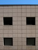 Four windows. Modern office building wall with four windows Stock Photo