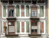 Four windows with balcony Stock Image