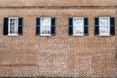 Four Windows with Black Shutters Royalty Free Stock Image
