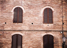 Four windows in a brick wall Stock Image