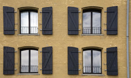 Four windows on the frontage of a house Royalty Free Stock Photo
