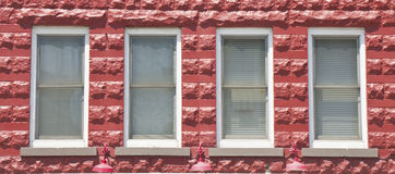 Four Windows in Red Block Building Stock Photography