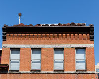 Four Windows with Shades on Old Brick Building Royalty Free Stock Images