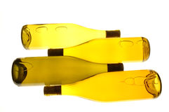 Four Wine Bottles. Four White wine Bottles on sides with whitelight table  background Stock Photography