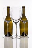Four wine glasses and two bottle Royalty Free Stock Photography