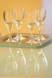 Four wine glasses with white wine Royalty Free Stock Photos