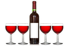 Four wineglass and wine bottle Stock Images