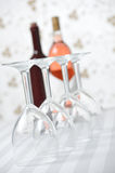 Four Wineglasses and Two Wine Bottles Royalty Free Stock Photos