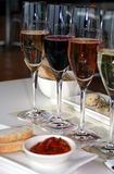 Four Wines and a dip. Australian wines with a cheese plate, tomato relish and bread Stock Photos