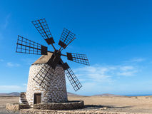 Four wing round windmill on the Canary Island. Royalty Free Stock Photos