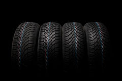 Four winter tires isolated on black background Royalty Free Stock Photography