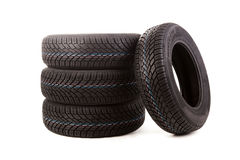 Four winter tires isolated on white background Royalty Free Stock Photos