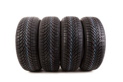 Four winter tires isolated on white background Royalty Free Stock Photography