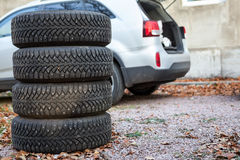 Four winter tyre wheels are near suv, copyspace Royalty Free Stock Photography