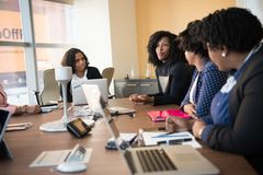 Four Woman at the Conference Room Stock Photos