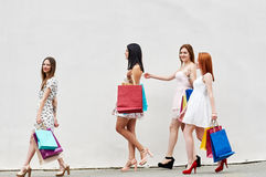 Four Women best friends with Shopping Bags Stock Photography