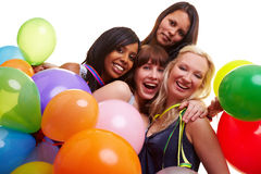 Four women celebrating New Year's Stock Photos