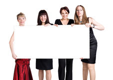 Four women holding blank white poster Stock Photos
