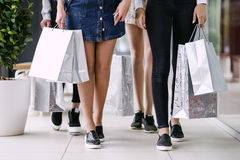 Four women with a lot of shopping bags royalty free stock photos