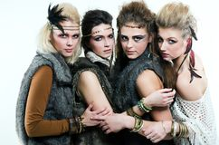 Four women. Four native friends with interesting hairstyles Royalty Free Stock Photo