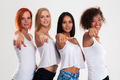 Four women pointing fingers at camera Stock Photography