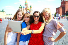 Four women at the red square in Moscow Stock Photography