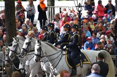 Four women soldiers on horses on Prinsjesdag. THE HAGUE, HOLLAND - SEPTEMBER 19, 2017: Soldiers accompanying the Golden Coach with Queen Maxima and King Willem Royalty Free Stock Images