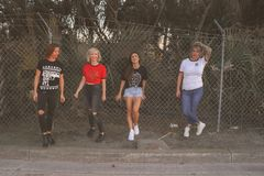 Four Women Standing Against Wire Fence Royalty Free Stock Images
