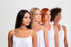 Four women standing in a raw Royalty Free Stock Photos