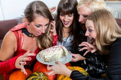 Four women wearing Halloween costumes while posing funny before Royalty Free Stock Photography
