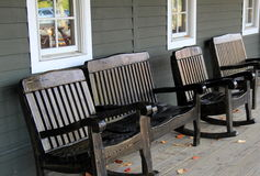 Four wood rocking chairs on front porch Stock Images
