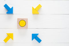 Four wooden arrows converge towards the center target Stock Photo
