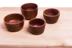 Four wooden bowls on cutting board Royalty Free Stock Image