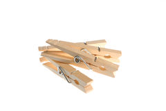 Four wooden clothespins. Isolated against a white background Stock Image