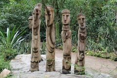 The Four Wooden Guardians. These 4 intricately crafted wooden sleek statues were believed to be the guardians of an ancient tribe Royalty Free Stock Image