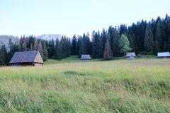 Four wooden hut among the mountains stock image