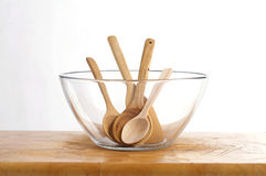 Four wooden spoon in bowl Stock Images