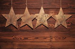 Four wooden stars for christmas Royalty Free Stock Photo