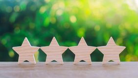 Four wooden stars. The concept of rating and evaluation. The rating of the hotel, restaurant, mobile application. Quality service,. Buyer choice. Success in royalty free stock photo