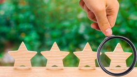 Four wooden stars. The concept of rating and evaluation. The rat. Ing of the hotel, restaurant, mobile application. Quality service, buyer choice. Success in stock photos