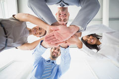 Four workers stacking hands together Royalty Free Stock Images